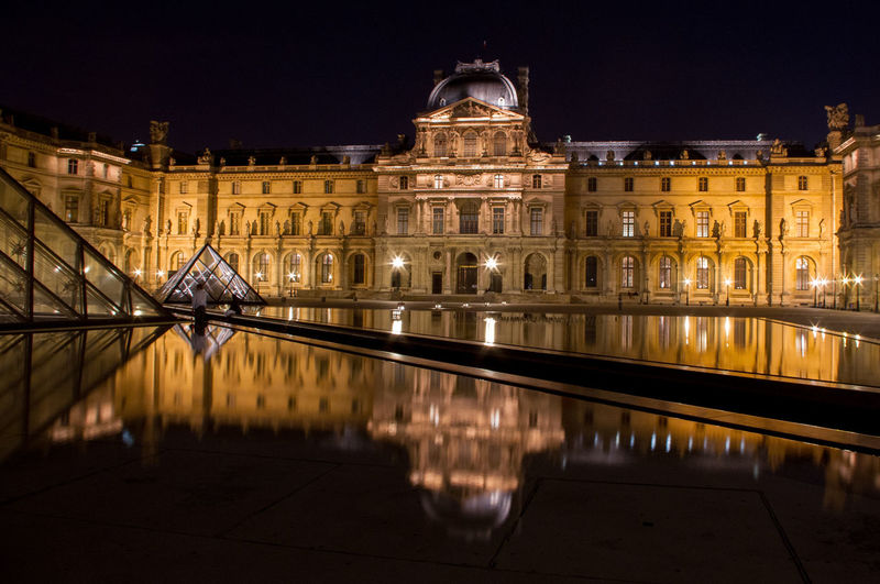The Louvre in Paris, France shot at night with reflections from the pools Louvre Museum Louvre Pyramid Louvre, France Paris Night Night Photography Reflection Palace Museum Pyramid Architecture Europe European  Toursim Pond