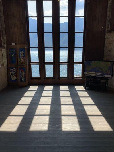 View of sea through open window
