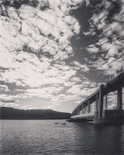 Water Bridge - Man Made Structure Connection Built Structure Architecture Sky Mountain Scenics Transportation Tranquil Scene Beauty In Nature Waterfront River Engineering Cloud Tranquility Cloud - Sky Bridge Beauty In Nature Nature Day