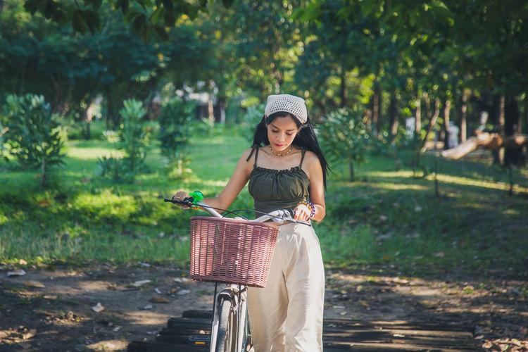 Full length of man riding bicycle in basket