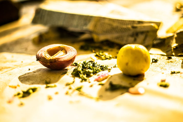 Close-Up Of Onion And Lemon On Table