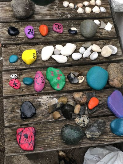 High angle view of multi colored stones on table