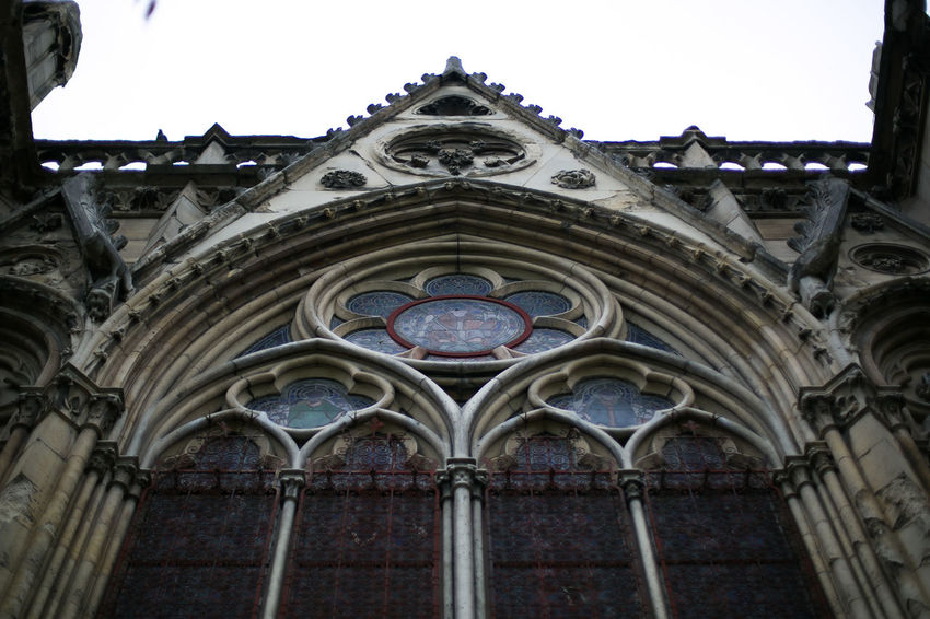 Details of Notre Dame de Paris cathedral in Paris, France Architecture Beautiful Cathedral Church Economy France Notre Dame De Paris Paris Statue Travel Architectural Feature Building Exterior Dark Light Details History Low Angle View No People Outdoors Parisian Place Of Worship Real Estate Religion Rose Window Spirituality Window