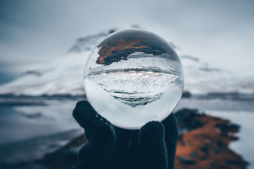 Kirkjufell mountain in Iceland through glass ball Crystal Ball Glass Ball Iceland Kirkjufell Kirkjufell Mountain Reflection Beauty In Nature Close-up Cold Temperature Creative Crystal Ball Crystal Ball Photography Day Environment Focus On Foreground Frozen Ice Melting Nature No People Outdoors Reflection Scenics - Nature Sky Snow Sphere Transparent Upside Down Water Winter