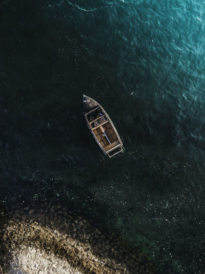 High angle view of abandoned floating on sea