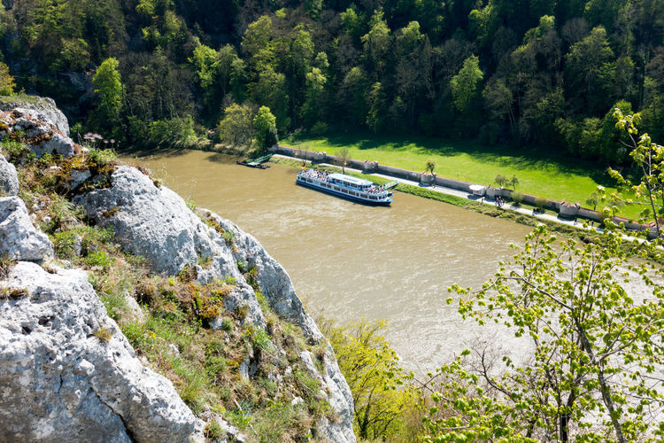 View from a rock down to the Tourist ship drop off Point of monastery Weltenburg Ausflug  Beauty In Nature Dampferfahrt Day Donau Donauschifffahrt Forest Green Color Growth Kehlheim Nature Nautical Vessel No People Outdoors River Rock - Object Scenics Sky Tranquility Transportation Travel Tree Wanderlust Water Weltenburg