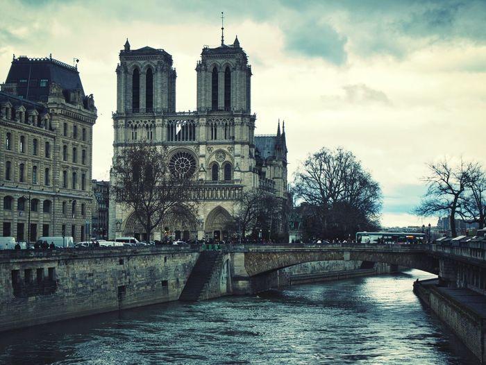 Notre Dame Paris Built Structure Architecture Building Exterior Sky Building Water Cloud - Sky City Day River Travel Destinations Outdoors Waterfront