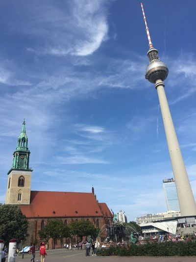 Low Angle View Of St Mary Church And Fernsehturm Against Sky