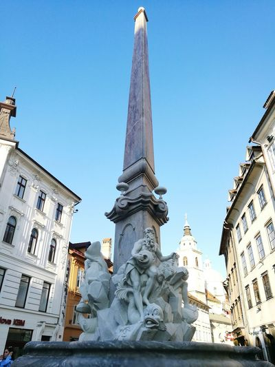 Statue Art And Craft Human Representation City Sculpture Female Likeness No People Architecture Travel Destinations Outdoors Clock Face Day Astrology Sign Ljubljana Robbov Vodnjak Robba Statue Monument City Centre