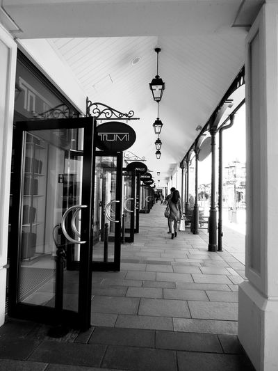 window shopping Retail  Store Small Business Hanging Market Built Structure Adult Day Architecture People Full Length City Indoors  Adults Only Black & White Black & White Photography Monochrome Photography