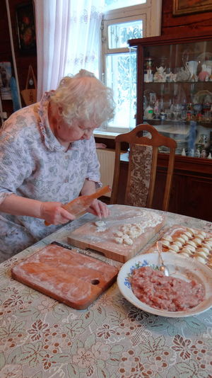 Senior Woman Preparing Dumplings At Home