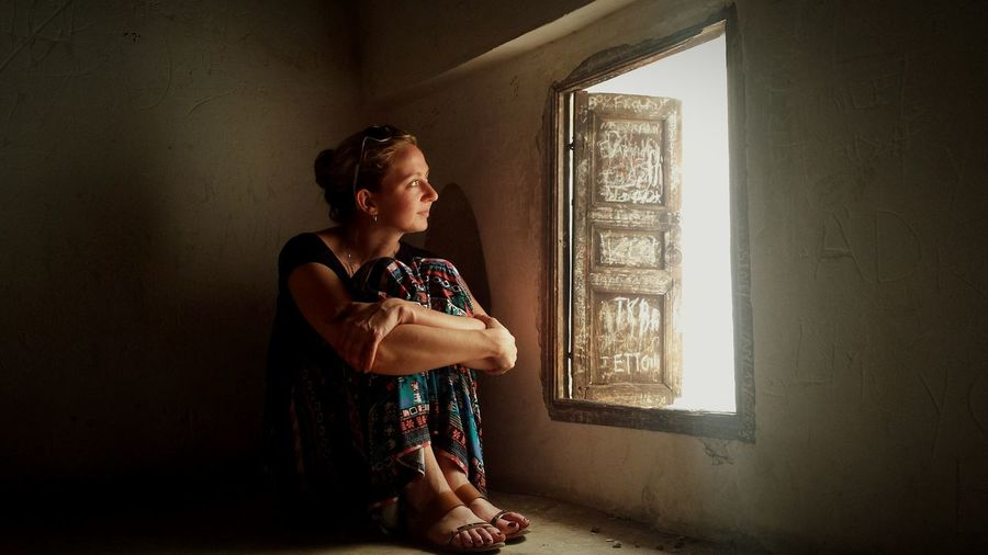 This shot was unexpected. My better half found a tiny, rickety ladder in the Ben Youssef Madrasa leading to a dusty little room, forgotten about by all but the most curious visitors. She was just watching, soaking in the crazy bustle of the city from this solitary refuge. I love her, and I love the image. Natural Light Portrait Travel Photography Morocco Marrakech Explore Light And Shadow Portrait Mystery First Eyeem Photo EyeEm Masterclass EyeEm Best Shots EyeEmBestPics EyeEm Gallery Travel Destinations Ben Youssef Madrasa Fine Art Photography People And Places