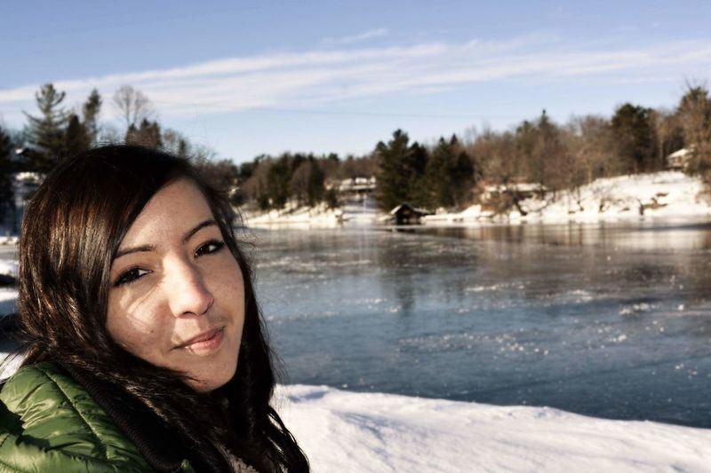 Portrait Of Young Woman By Frozen River