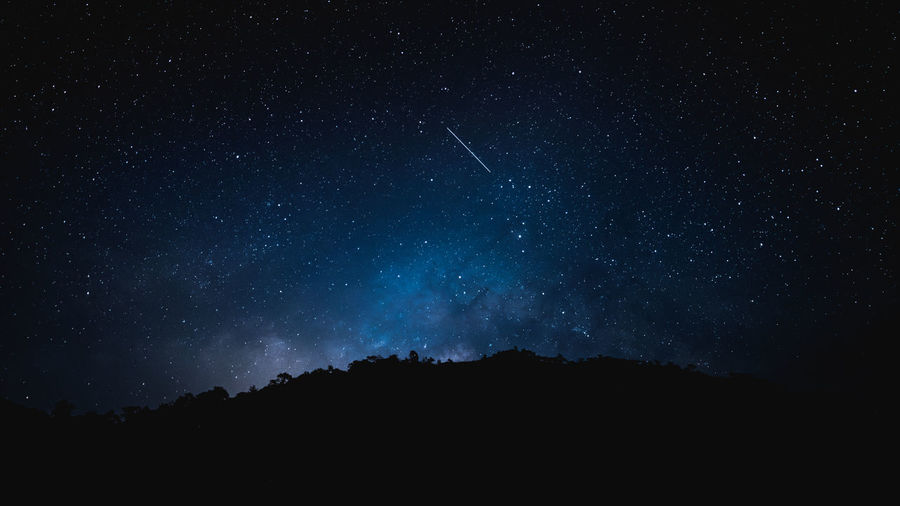 Meteor and milky way star in the night before sunrise
