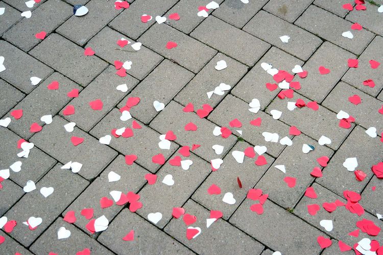 High Angle View Of Heart Shaped Confetti On Footpath