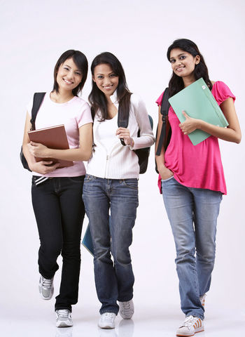 young women going to school Asian  Happiness Indian Standing Back Pack Book Casual Clothing Chinese Education Friendship Full Length Going To School Harmony Holding Malay Multi Racial Portrait Positive Emotion Studio Shot Togetherness University Student Walking White Background Women Young Adult