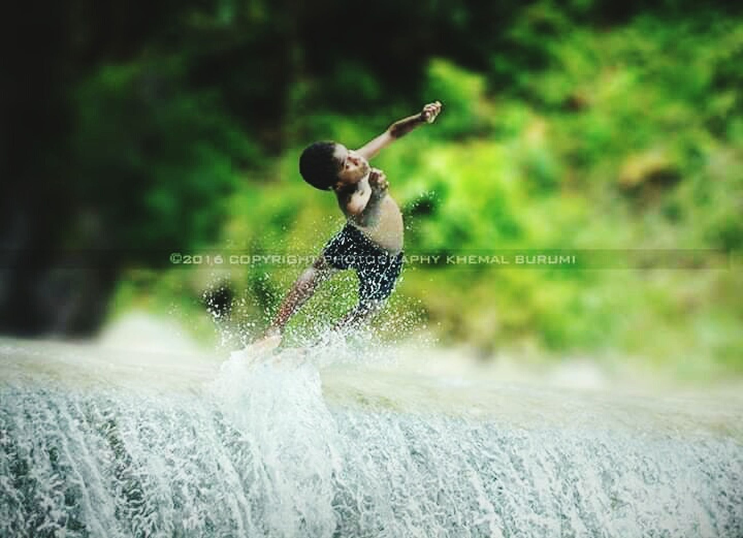 motion, water, splashing, one person, men, nature, males, sport, fun, childhood, child, leisure activity, playing, enjoyment, boys, adult, day, human arm, outdoors, arms raised, spraying, excitement