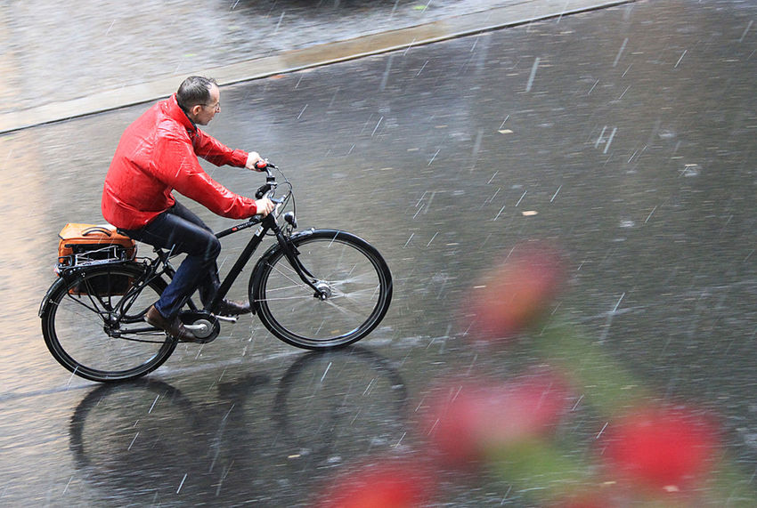 a man drivin through the rain with his bike Bicycle Blur Calamity Celebrate Your Ride Cycling Fahrrad Fahrradfahrer Land Vehicle Man Peche Rain Rainy Real People Red Regen Straße Street