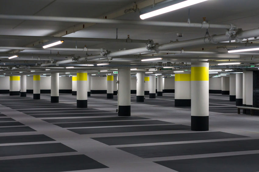 Utrecht Bycicle Parking Lot The Architect - 2018 EyeEm Awards Absence Architectural Column Architecture Basement Built Structure Ceiling Empty Flooring Fluorescent Light Illuminated In A Row Indoors  Light Lighting Equipment Mode Of Transportation No People Parking Garage Parking Lot Public Transportation Sign Subway Transportation