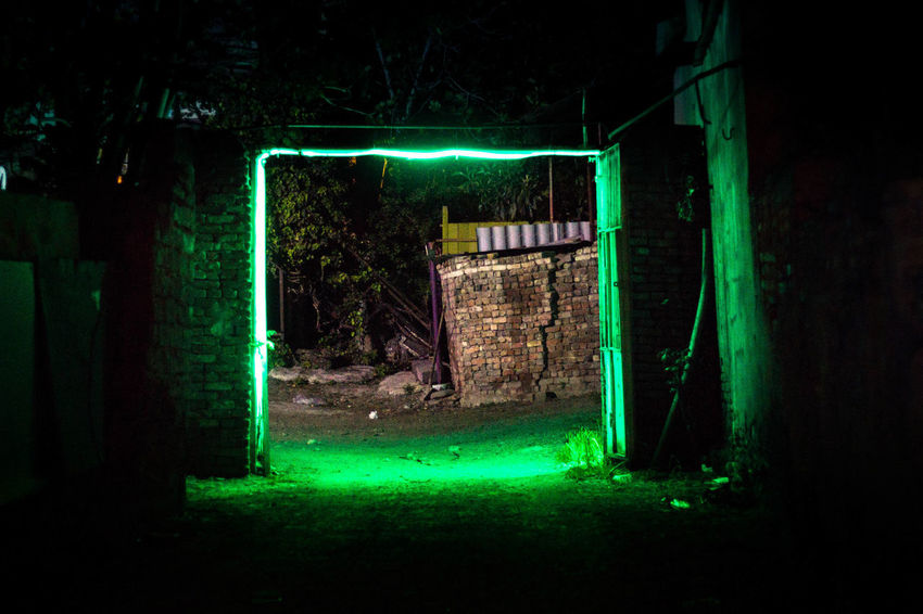 Abandoned Architecture Bizarre Built Structure Dark Door Entrance Fear Glowing Green Color Illuminated Lighting Equipment Mystery Neon Night No People Open Outdoors Run-down Spooky