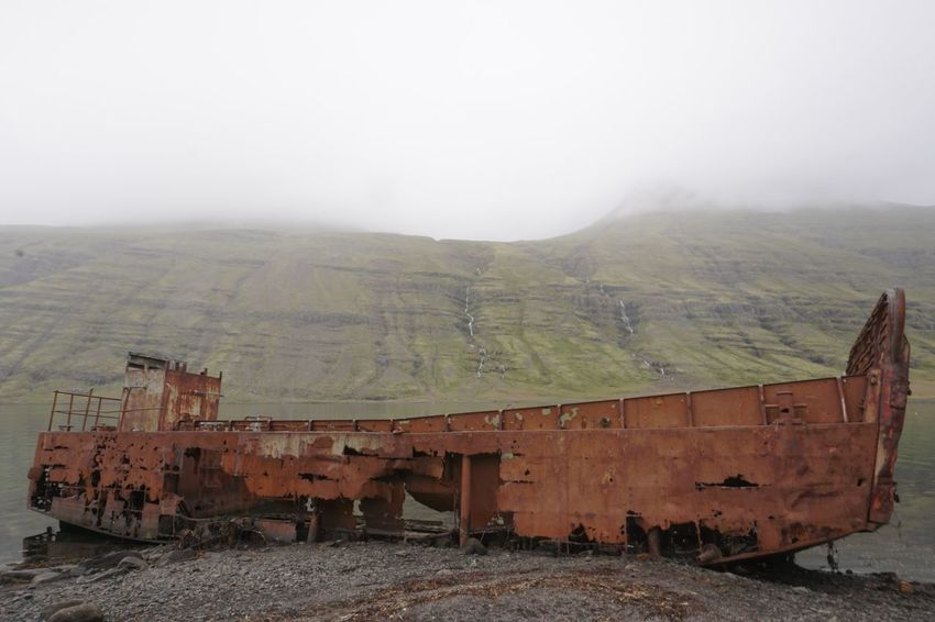 Agriculture Mjóifjörður Beyond Repair Boat Day Fog Landscape Mountain Nature No People Outdoors Rusted Hu Rusted Metal  Scenics Sky