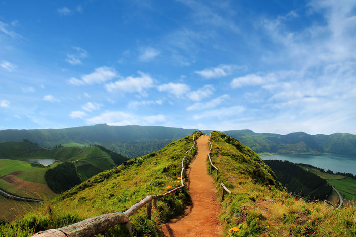 Walking path leading to a view on the lakes of Sete Cidades Beauty In Nature Blue Cloud - Sky Grass Green Color Lake Landscape Mountain Nature Scenics Sete Cidades Azores Sky Tranquil Scene Tranquility Tree Walking Path