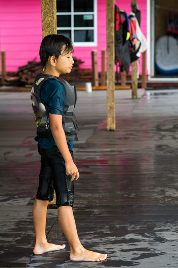 Full length of boy standing in street