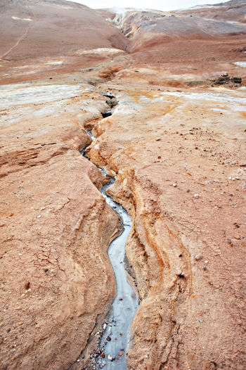 Hverir geothermal area in of iceland, volcano cracked red ground, alternative energy, namafjall