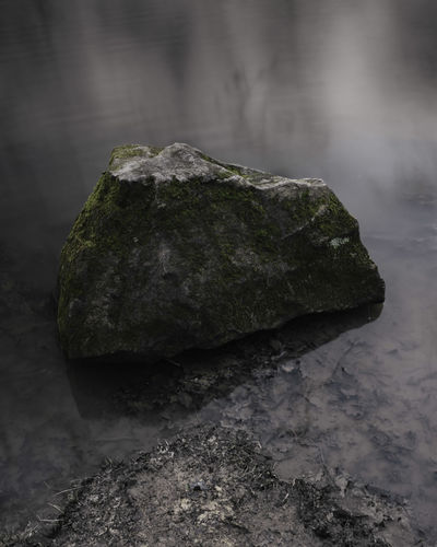 Close-up of rock on water