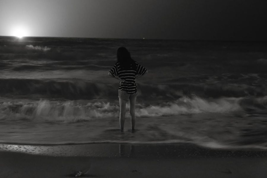 Waiting Wait Night Wave One Person One Girl Only Childhood Beauty In Nature Nightphotography Night Lights Night Sea Beach Sea Outdoors Children Only Child Nature Water Black And White Sand Sky