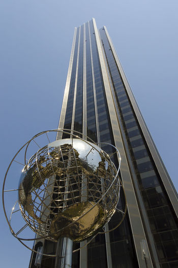 New-York-City, USA - May 4, 2015: globe structure in front of Trump hotel on Columbus Circle in Manhattan Trump Hotel Architecture Building Building Exterior Built Structure City Clear Sky Day Editorial  Editorial Use Only Glass - Material Global Communications Globe - Man Made Object Low Angle View Metal Modern No People Office Building Exterior Outdoors Sky Skyscraper Sphere Steel Tall - High Tower