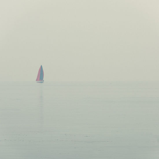 Beauty In Nature Clear Sky Day Fog FogyDay Gardalake Italy Horizon Over Water Nature Nautical Vessel Navigation No People Outdoors PeschieraDelGarda Sailboat Sailing Scenics Sky Solitary Tranquility Vacations Verona Italy Water Waterfront