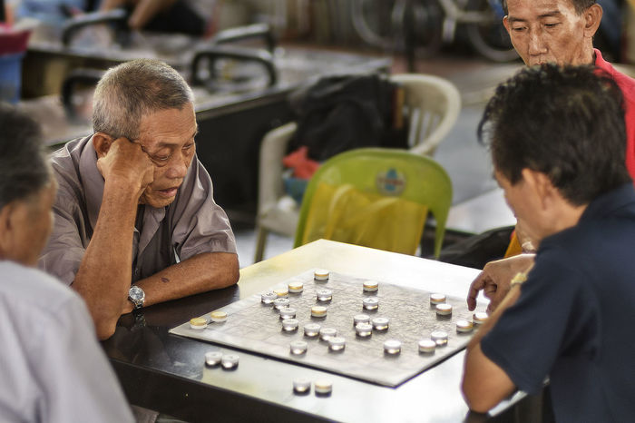 Old men playing Chinese chess in chinatown, singapore Board Game Chinatown Chinese Chess Elderly Playing Chess Thinking