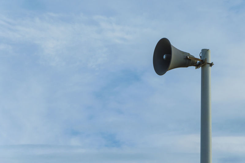 Low angle view of megaphone against sky