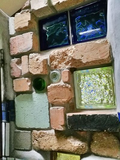 Wall in one of rhe cubicles Crafted Beauty Hundertwasser Toilet Block In Kawakawa New Zealand From My Point Of View The Week On Eyem Architecture EyeEm Gallery EyeEm Diversity Art Is Everywhere Window Indoors  Green Color Built Structure