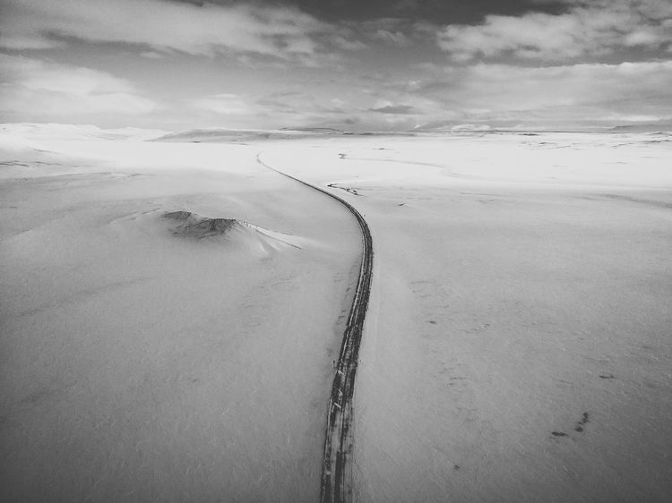 Black and white Drone  Landscape Photography Mavic Air Beauty In Nature Cloud - Sky Cold Temperature Day Diminishing Perspective Direction Environment Land Landscape Nature No People Non-urban Scene On The Road Outdoors Road Scenics - Nature Sky Snow The Way Forward Tranquil Scene Tranquility Transportation