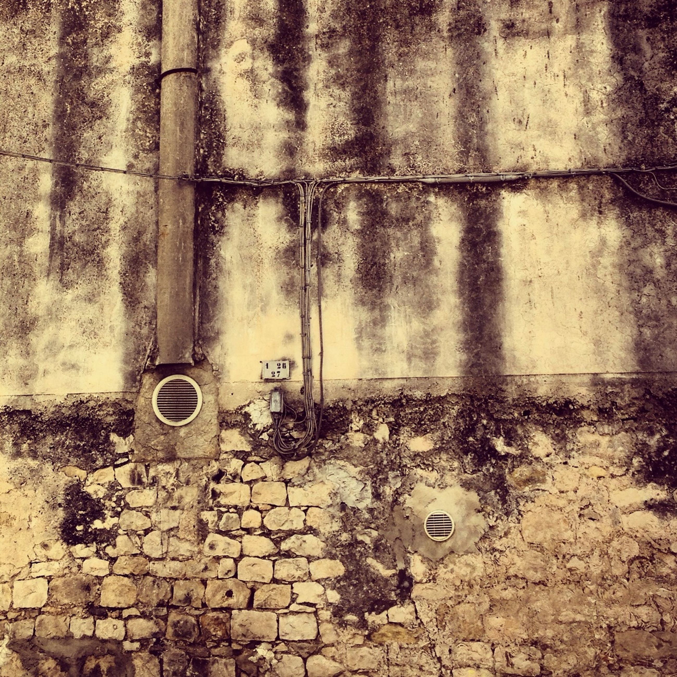 abandoned, wall - building feature, obsolete, damaged, old, run-down, deterioration, built structure, brick wall, weathered, architecture, no people, day, outdoors, metal, messy, wall, bad condition, dirty, building exterior