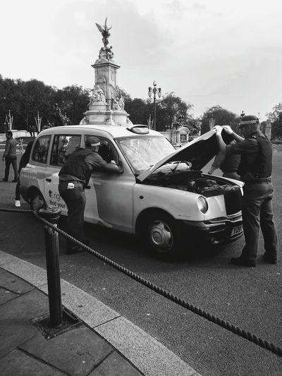 The Street Photographer - 2017 EyeEm Awards Outdoors Day City People Police Policeman Blackandwhite Car Control Car Police Patrol London London Lifestyle London Streets