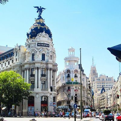 Strolling down the street in a beautiful summer sky of Madrid, Spain (August 2014).
