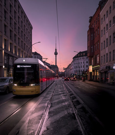 Sonnenaufgang am Rosenthaler Platz. Transportation Mode Of Transportation Railroad Track Rail Transportation Street Public Transportation Building City Street Illuminated Sunset City Life No People Office Building Exterior Fernsehturm Berlin Bvg Sunrise EyeEmNewHere EyeEm EyeEm Best Shots EyeEm Selects