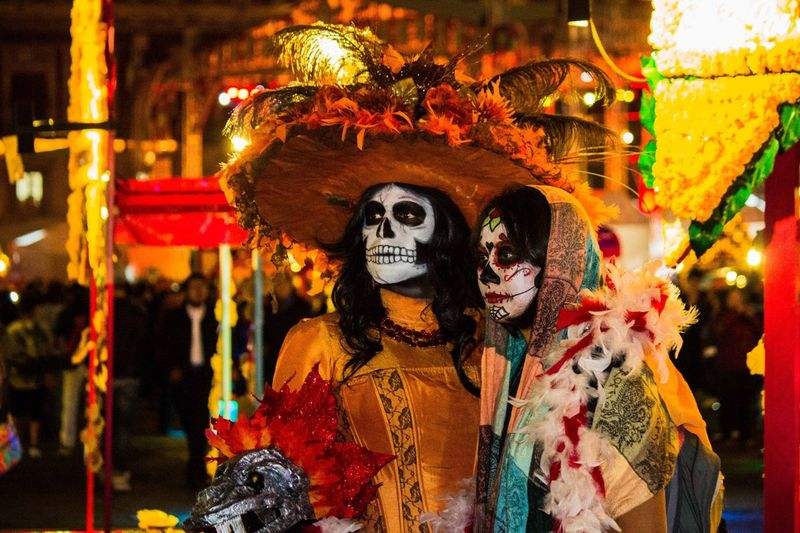 Close-Up Of People With Spooky Make-Up At Night During Carnival