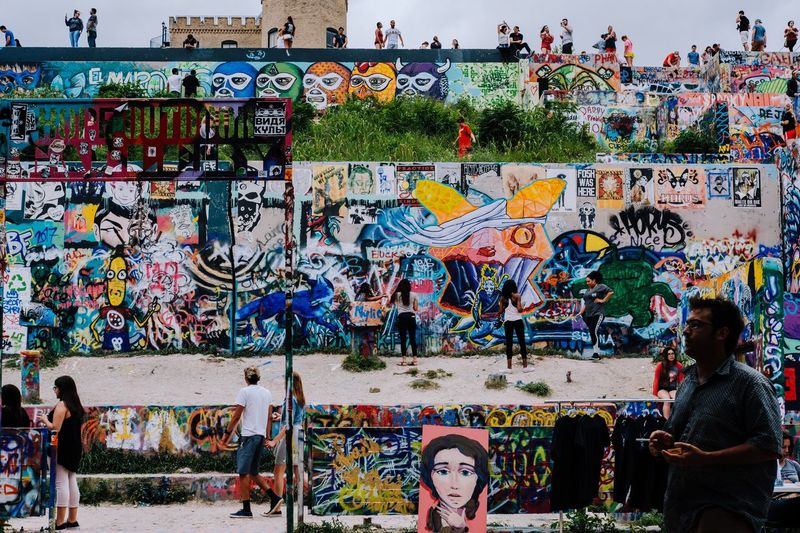 Group of people against graffiti wall