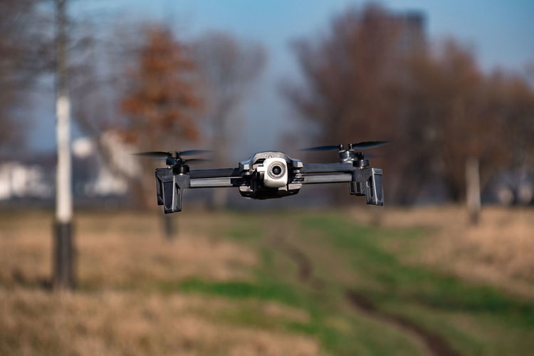 Technology Transportation Drone  Camera - Photographic Equipment Nature Mid-air Flying No People Mode Of Transportation Motion Day Photography Themes Tree Surveillance Focus On Foreground Security Outdoors Sky Plant Land Parrot Anafi