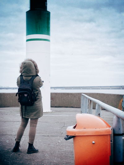 Full Length Of Woman Standing Against Lighthouse