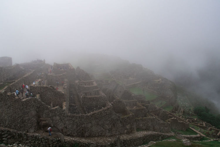 Fog Architecture History The Past Travel Destinations Ancient Built Structure Tourism Nature Travel Tourist Day Building Exterior Ancient Civilization High Angle View Outdoors Sky Group Of People Archaeology Machu Picchu Inca Inca Ruins