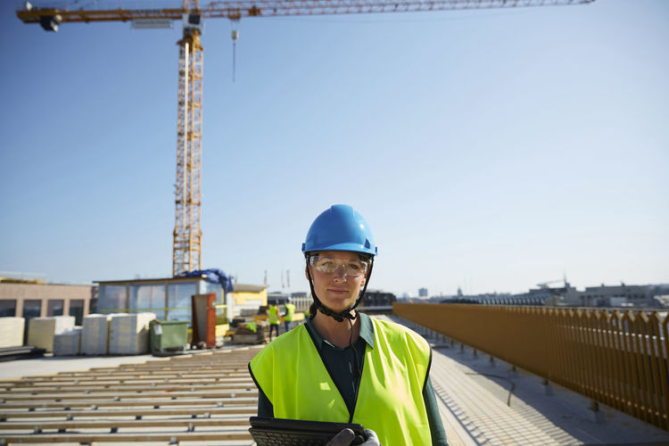 Portrait of man wearing construction site against sky