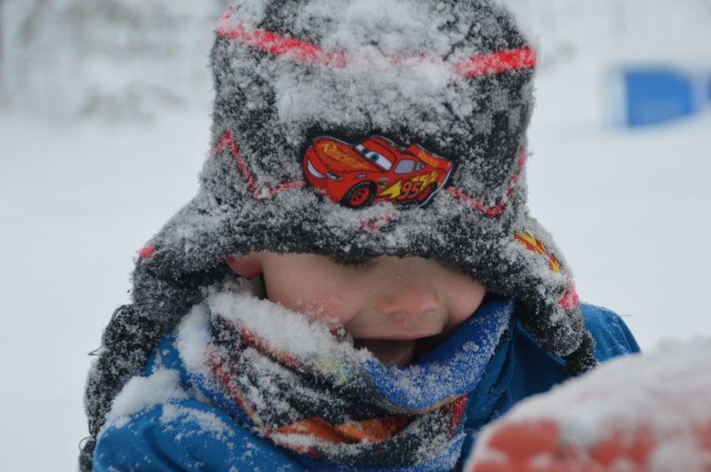Portrait of boy in snow