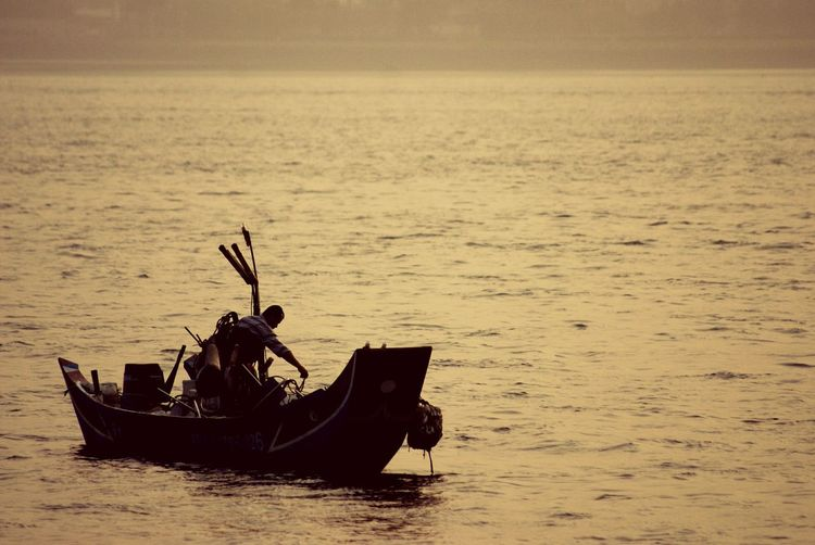 Fishing Time Snapshots Of Life Fishing Boat Fishermen Sunset Silhouettes Silhouette Waves Ocean Life My Country In A Photo The Human Condition