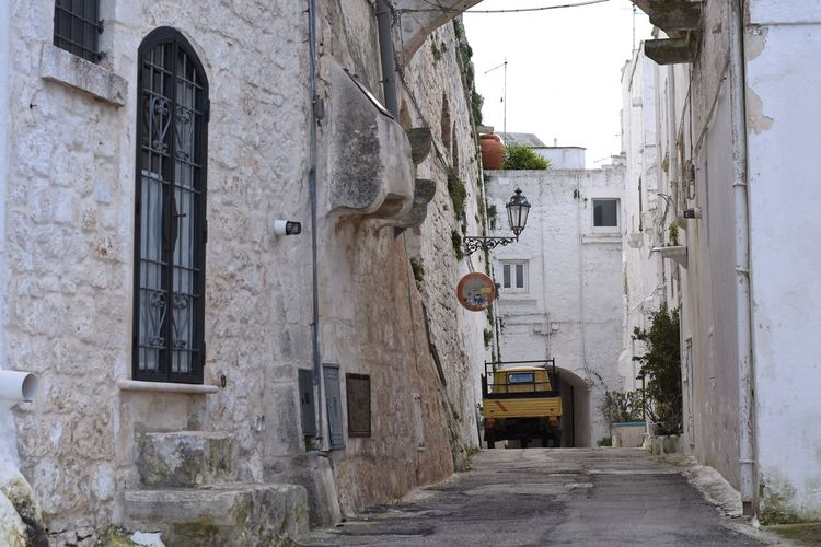 Architecture Built Structure Building Exterior Building Transportation City Mode Of Transportation Residential District Day No People Land Vehicle Street Road Motor Vehicle Direction Outdoors The Way Forward Nature Window Car Alley Apartment Puglia Puglia South Italy Ostuni