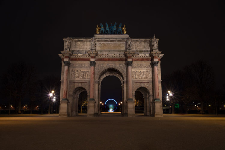 Low angle view of arc de triomphe du carrousel at night